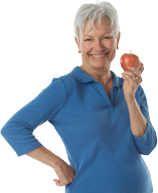 Woman with dental implants eating apple